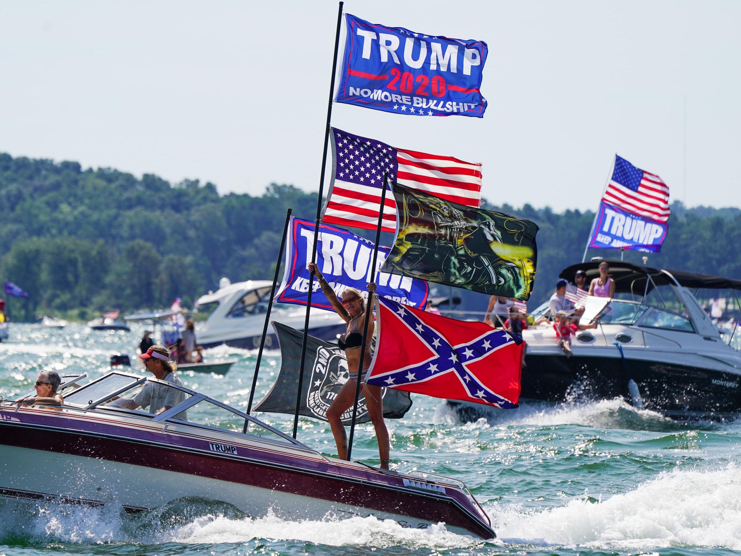 Boats adorned with US and Trump campaign flags are seen on Lake Lanier during a 'Great American Boat Parade' in Georgia