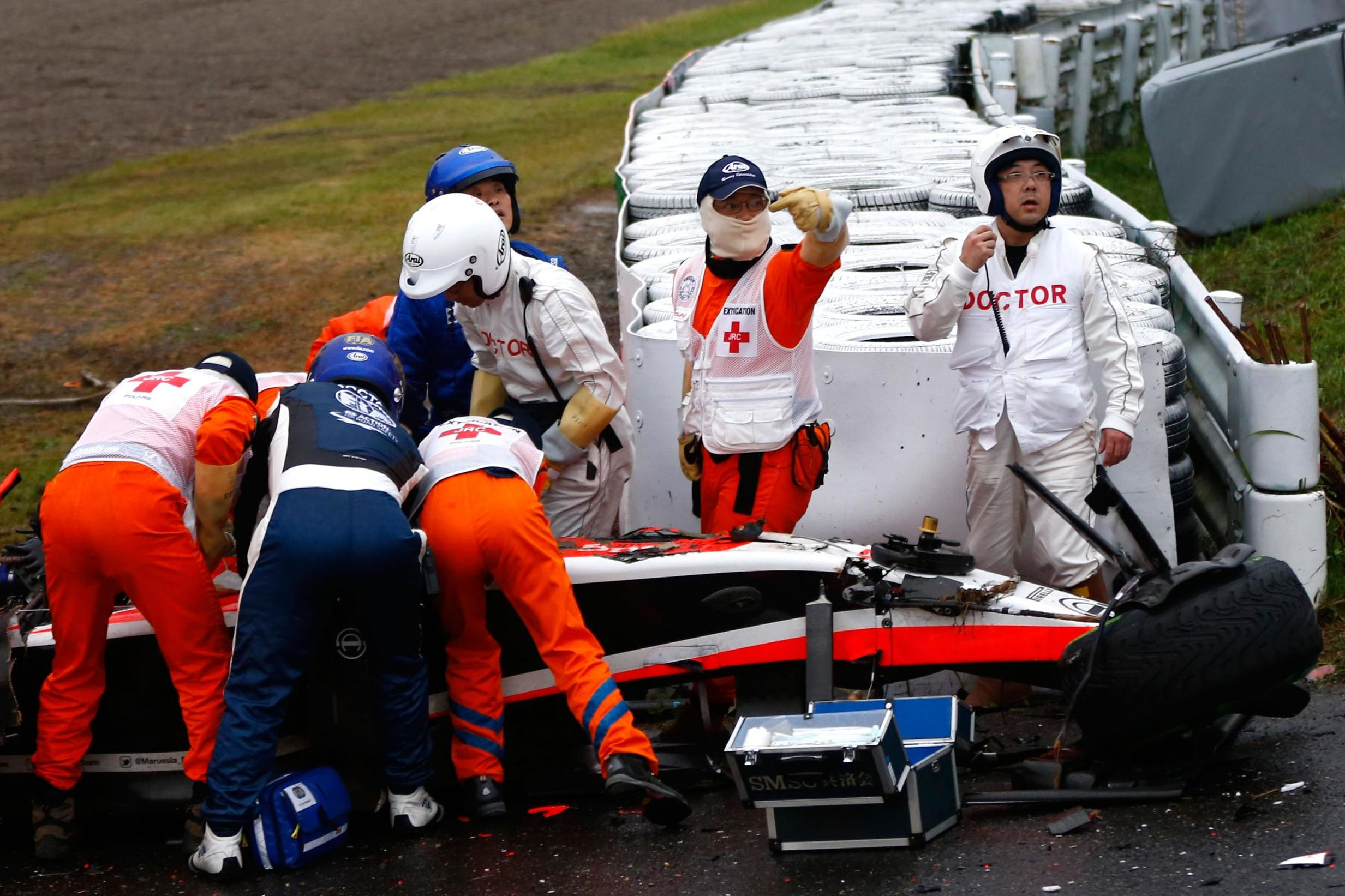 Bianchi receives medical treatment after crashing during the Japanese Formula One Grand Prix in 2014