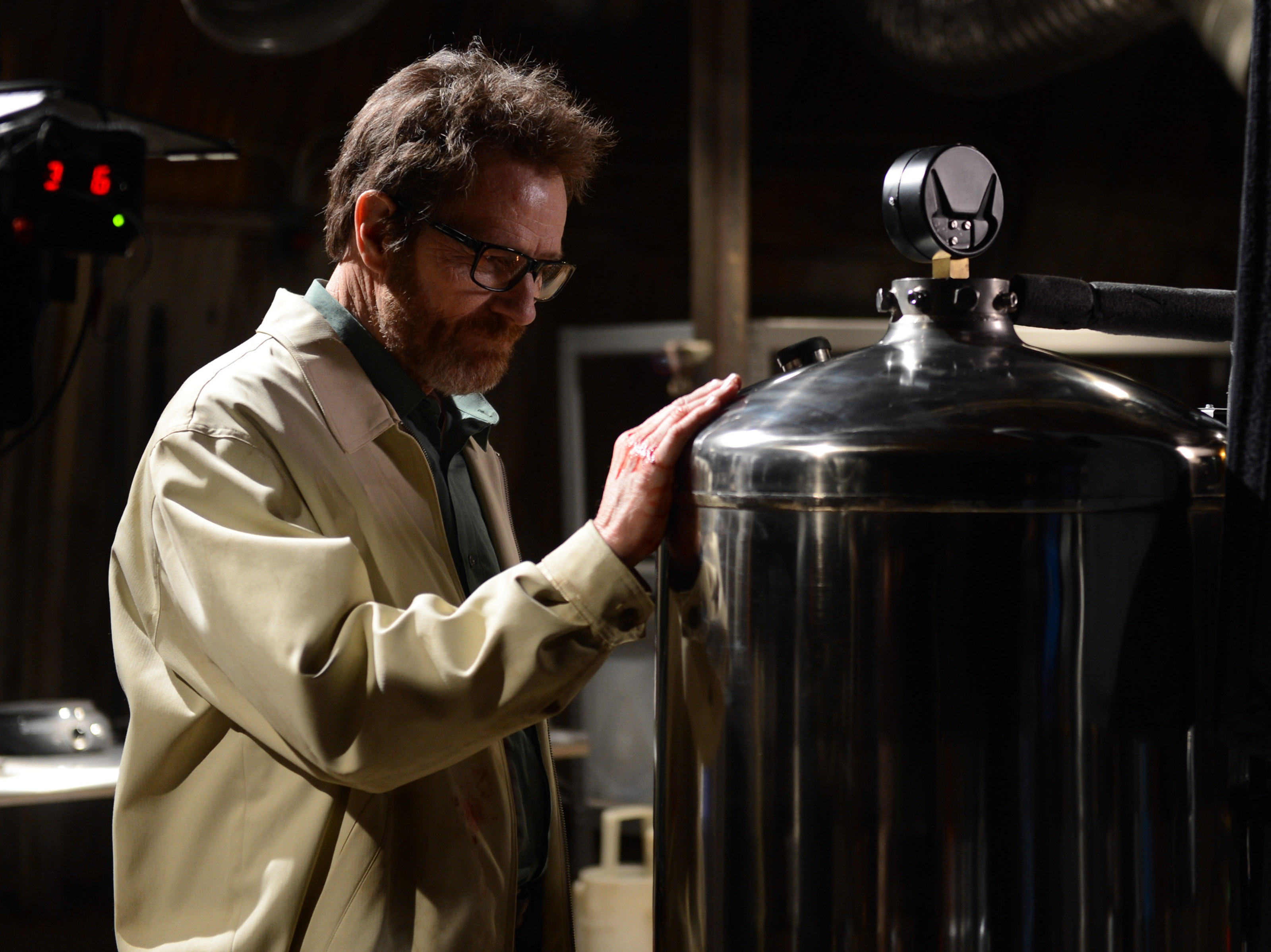 Walter White (Bryan Cranston) fondly runs his hand over a piece of meth-making equipment in the 'Breaking Bad' finale