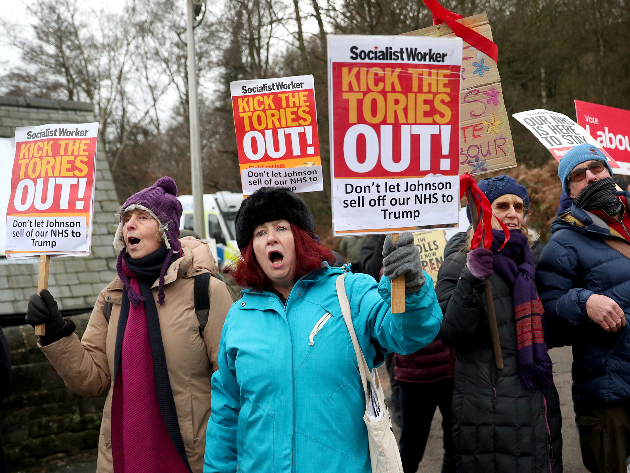 Protesters gather outside John Smedley Mill in Matlock ahead of the prime minister's arrival during the 2019 election campaign
