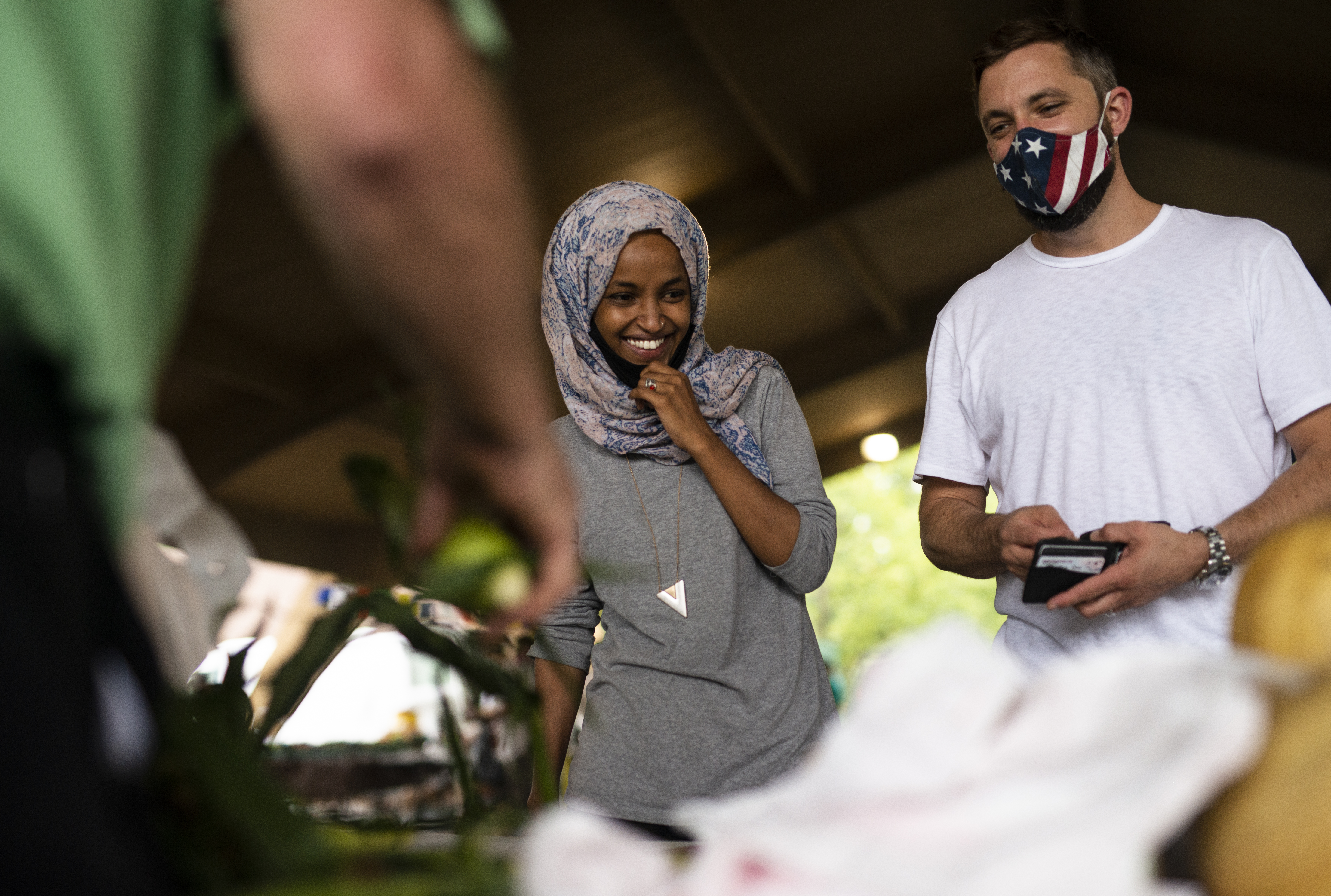 Ilhan Omar  campaigns with her husband Tim Mynett at the Richfield Farmers Market on 8 August 2020 in Richfield, Minnesota