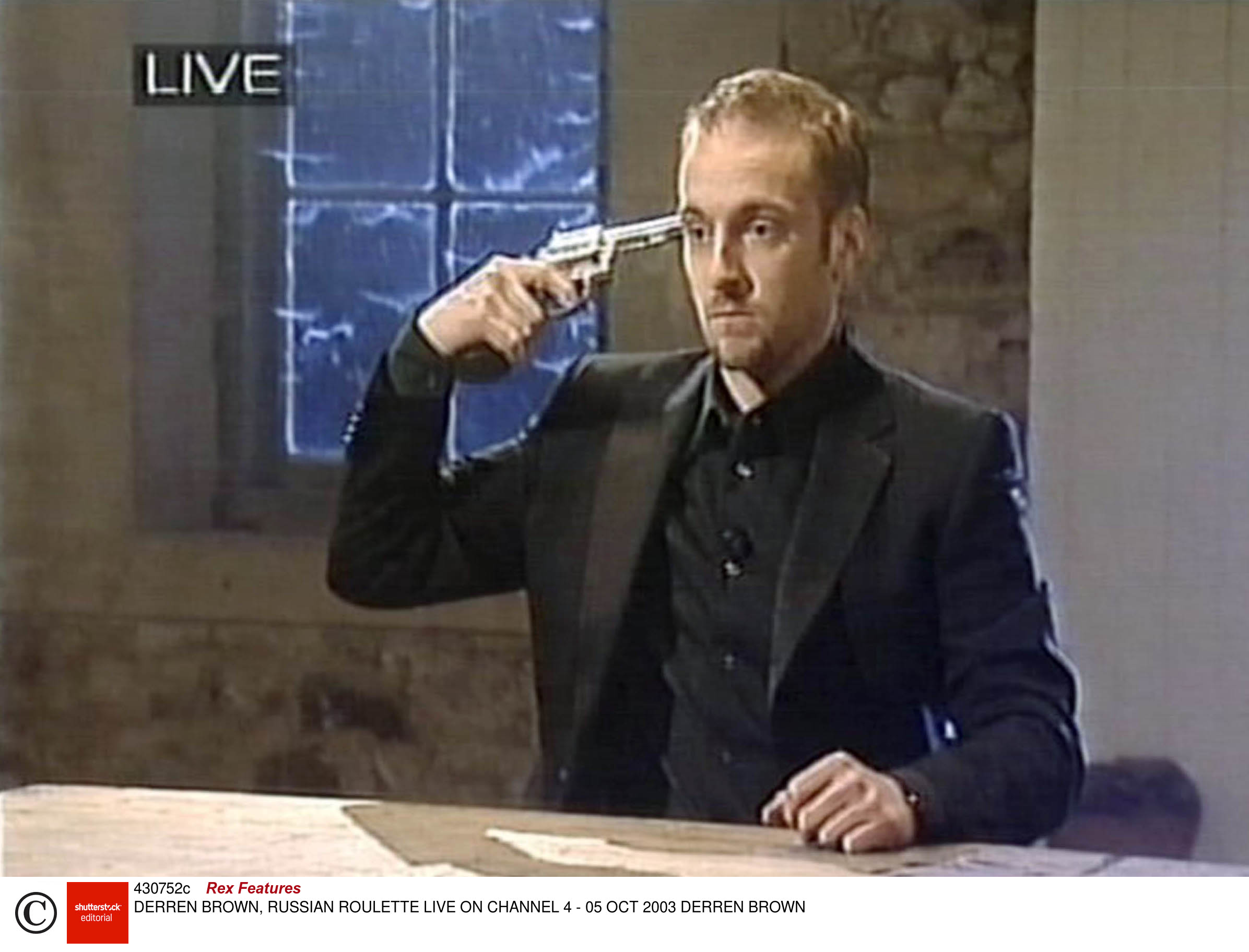Brown performs a Russian Roulette stunt on live television in 2003
