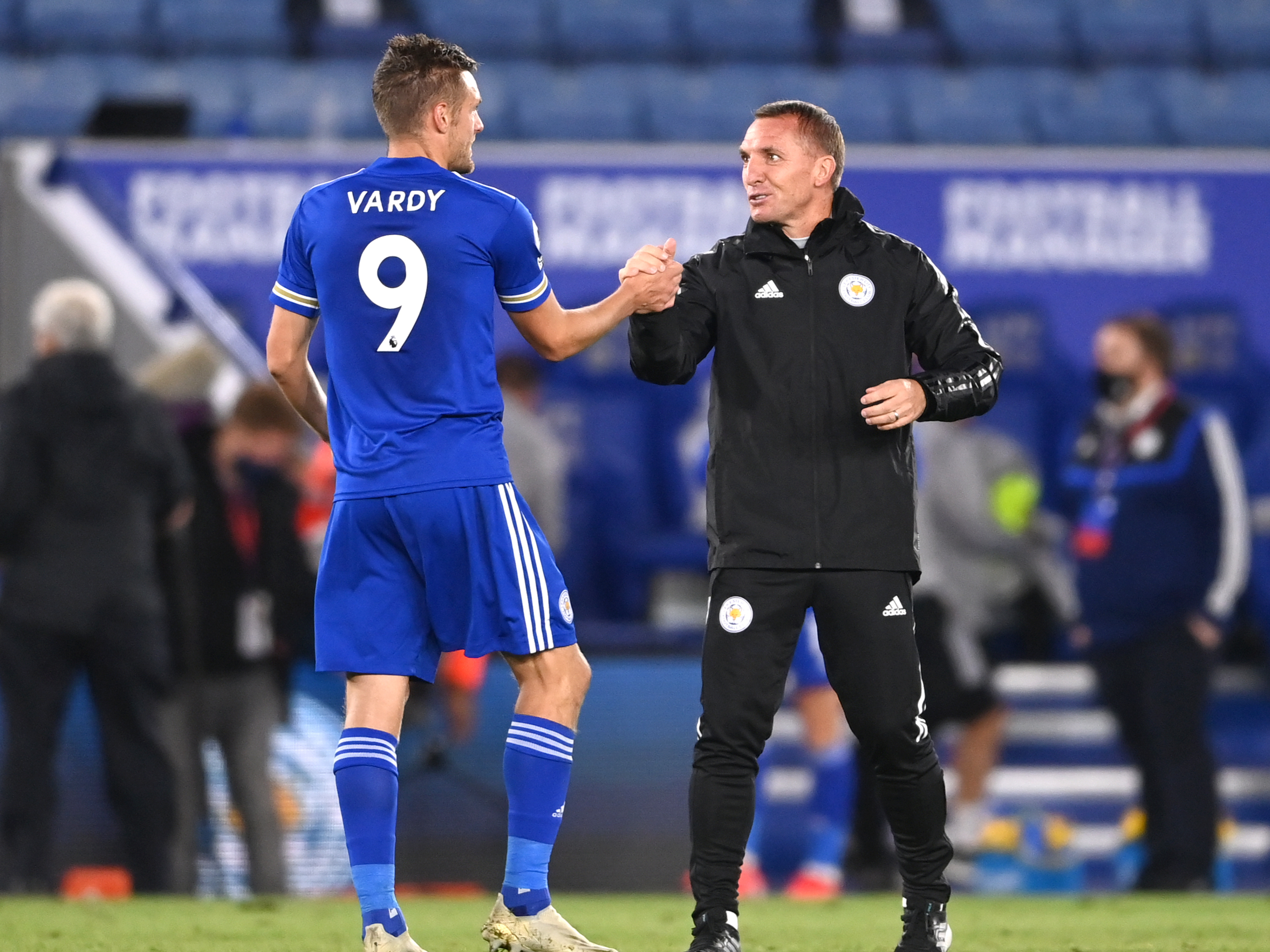 Jamie Vardy celebrates with Brendan Rodgers