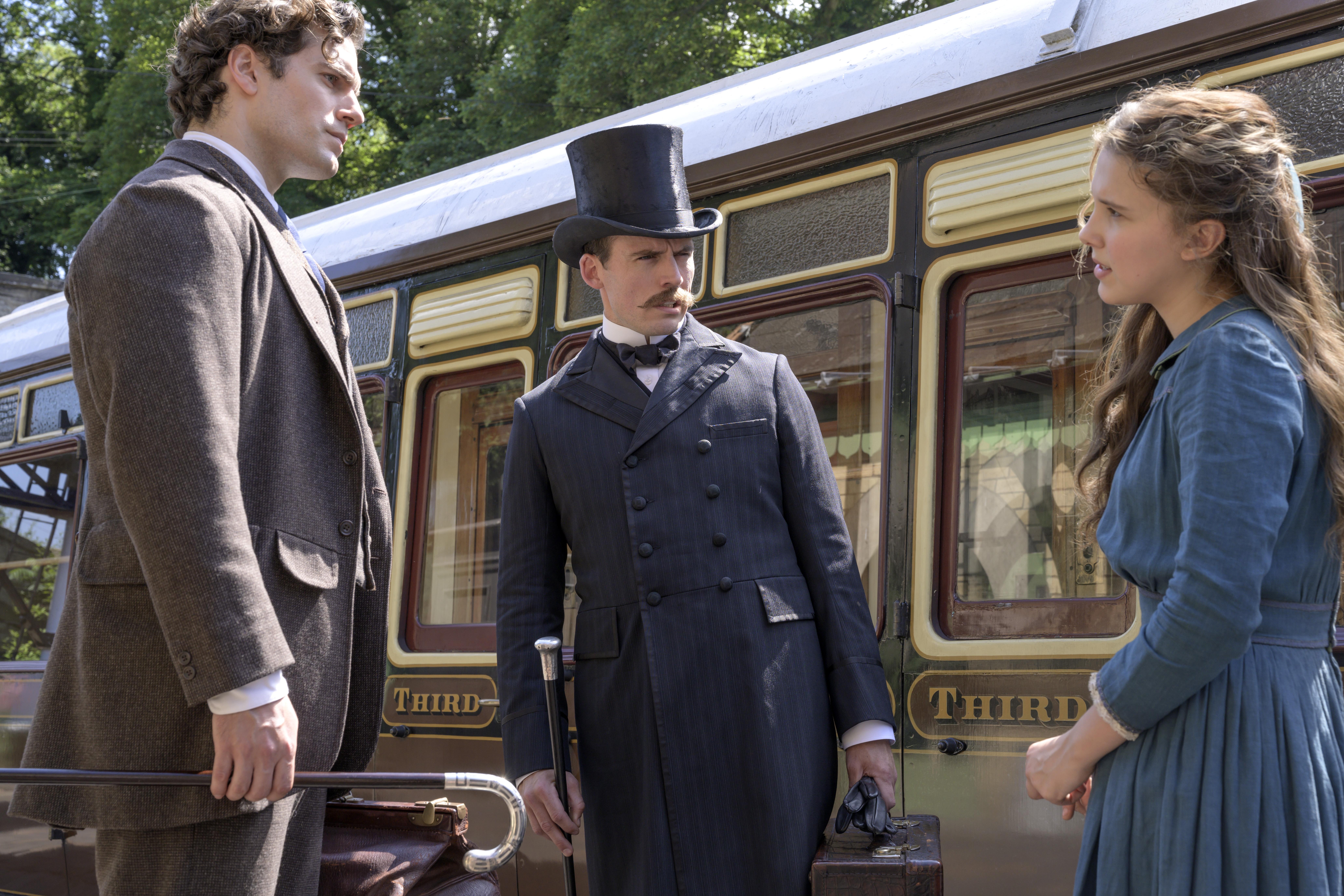 Sherlock (Henry Cavill), Mycroft (Sam Claflin), and Enola (Millie Bobby Brown) form the dysfunctional Holmes clan of Nancy Springer's books